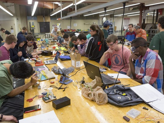 Watson School of Engineering and Applied Sciences freshmen build their projects at the machine shop in the Engineering Building in October 2015.