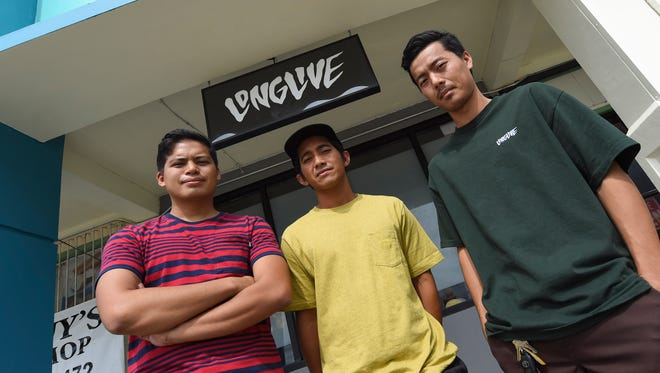 Long Live company members pose for the camera during a shoot at their shop in Tamuning on March 15, 2017. From left: Jeremiah Iglesias, Jeff Ejan, and Jun Cura.