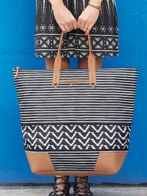 Getaway Black & Cream Stripe Expansion Bag, $138 at www.stelladot.com.