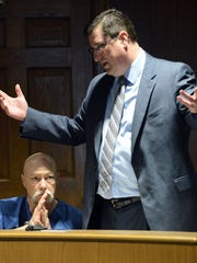 Jeffrey Hamm, left, listens as his attorney Andrew Stevenson speaks Thursday during a hearing in Fairfield County Common Pleas Court in Lancaster. Hamm pleaded guilty to one count each of possession of heroin and aggravated possession of drugs. He was sentenced to 16 months in prison. Hamm still faces murder charges in relation to the disappearance of his wife Terri Jo Hamm.