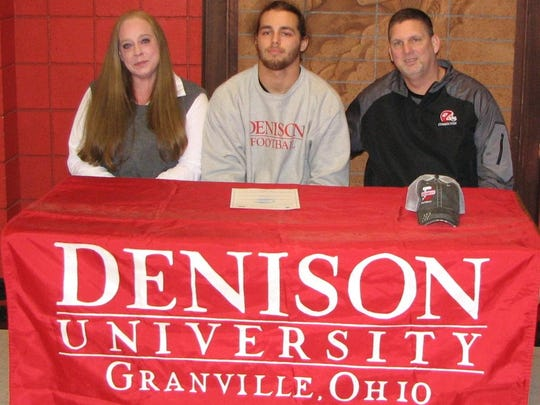 Coshocton senior Dallas Griffiths signed his letter of intent to play football at Division III Denison University on Wednesday. His mother, Amber Griffiths, and head football coach Jim Woodrum witnessed the signing.