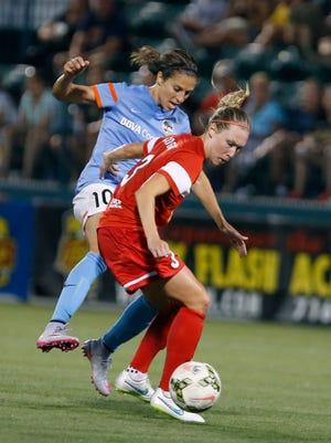 Houston's Carli Lloyd, left, pressures Whitney Engen in a match last year in Rochester.