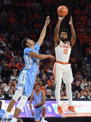Clemson guard Gabe DeVoe (10) shoots a jump shot over North Carolina guard Cameron Johnson (13) during the 1st half on Tuesday, January 30,  2018, at Clemson's Littlejohn Coliseum.