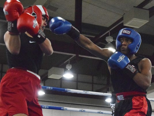 Elijah Dunbar (blue), 16, with the City of Alexandria Boxing Club fights Gabriel Chalmers of Jennings in the 2018 Cenla Showdown held Saturday, Oct. 6, 2018 at the Alexandria Riverfront Center. The showdown is an amateur boxing invitational open to boxers from  Louisiana, Mississippi, Arkansas and Texas. Dunbar was one of several Alexandria boxers who fought in the event.
