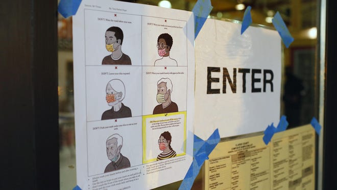 Mask-wearing guidelines posted Tuesday at the polling site at Clarke Central High School in Athens.