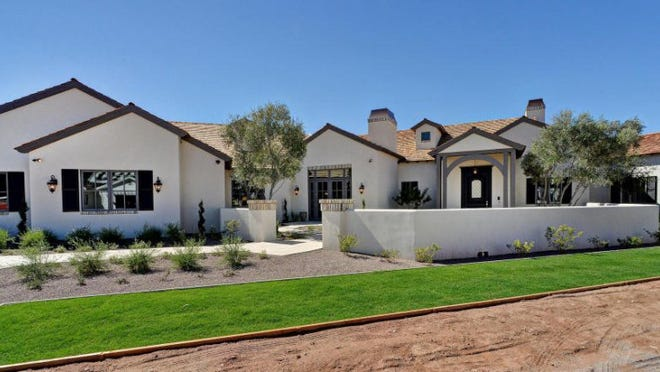 Andrew and Christine Burns paid $3.2 million for this six-bedroom, 6 1/2 bath, 6,815-square-foot house with pool built in 2014 in the Mountain View area of south Scottsdale. The sale closed during the week of Dec. 8, 2014.