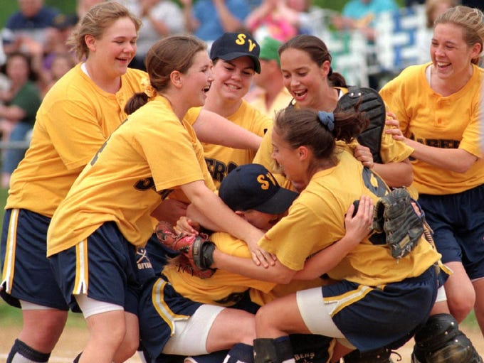 Susquehanna Valley pitcher Barb Cook is swarmed after