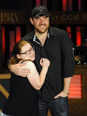 Make a Wish participant Molly Shannon 17, from Wilmington, Del., gets a hug from Chris Young during his fan club party at the Grand Ole Opry House on Wednesday in Nashville.