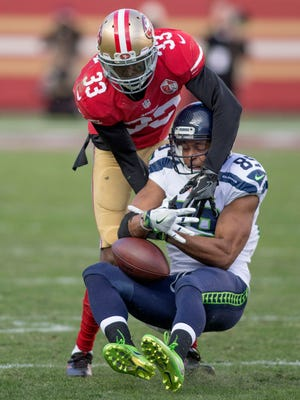 Seahawks wide receiver Doug Baldwin makes an acrobatic catch in the second quarter that sparked the offense.