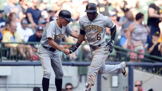 Pittsburgh's Starling Marte is congratulated by third base coach Rick Sofield following the third of three solo home runs for the Pirates Sunday afternoon against the Brewers at Miller Park.