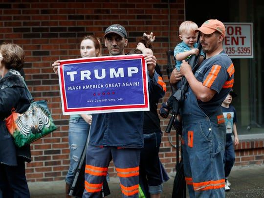 Coal miner Chris Steele holds a sign supporting Donald