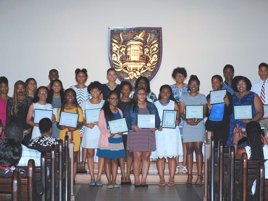 The Cosmopolitan Women's Club recently awarded numerous scholarships to minority students during a banquet at Elmira College.
