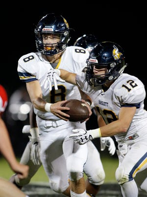 Haslett quarterback Hyrum Tibbitts, left, is one of the leading passers in the Lansing area.