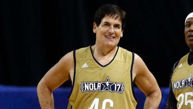Dallas Mavericks owner Mark Cuban, recording artist Master P and Los Angeles Sparks center Candace Parker during the All-Star Celebrity Game at Mercedes-Benz Superdome.