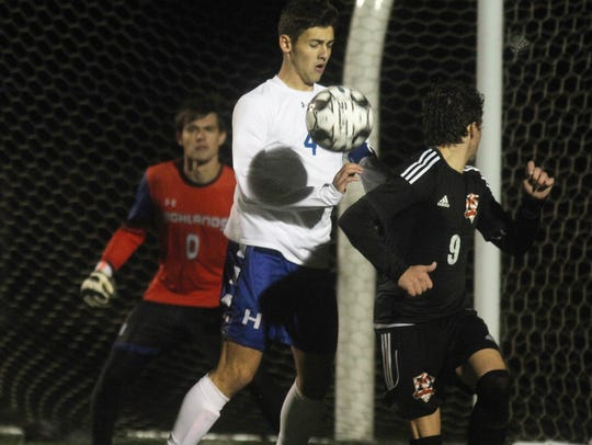 Highlands senior Alex Ford, 4, tries to keep the ball