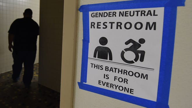Signs are posted outside the Santee High School's gender neutral restrooms at the school's campus in Los Angeles, California earlier this month