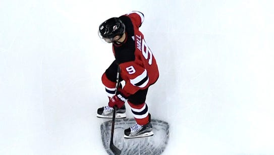 New Jersey Devils left wing Taylor Hall (9) and the
