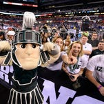 Apr 4, 2015; Indianapolis, IN, USA; Michigan State Spartans mascot Sparty poses with the student section before the semifinals of the 2015 Final Four of the NCAA Tournament against the Duke Blue Devils at Lucas Oil Stadium. Mandatory Credit: Bob Donnan-USA TODAY Sports