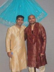 Alpesh Pawar, left, and Harish Kalvakota stand in front