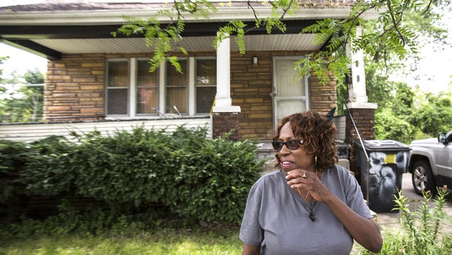 Lela Whitfield, 56, stands in front of her childhood home on Manistique street on the east side of Detroit on Thursday, July 30, 2015. After a two-year legal battle with Fannie Mae, represented by Trott & Trott law firm, Whitfield will be evicted, because of a reverse mortgage her mother took out on the home before she passed. Whitfield wants to buy back the home for market value of $9000.