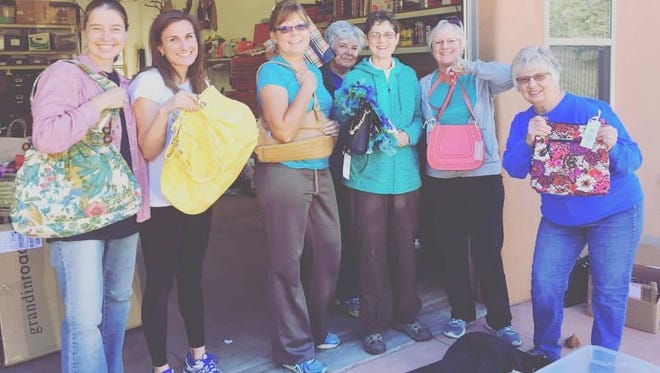 Silver City Chapter BR P.E.O. members exhibit some of the elegant purses that will be auctioned off at the annual PUrse and Silent Auction.
