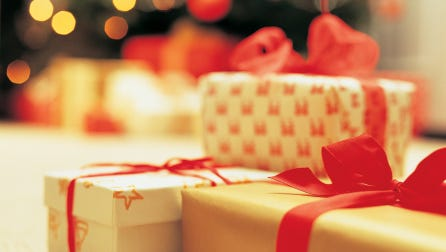 A stock image of presents and a Christmas tree.