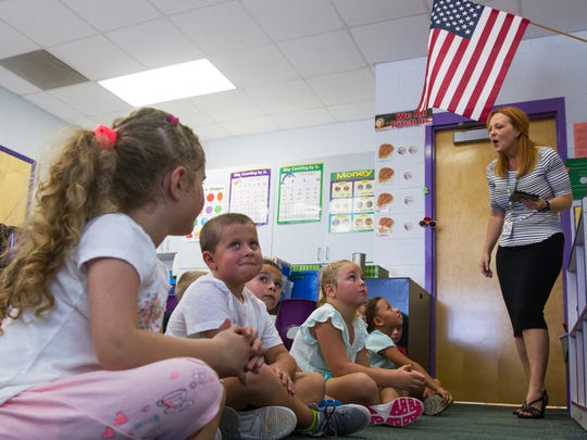 Leslie Mikell, a first grade teacher at Gulf Elementary School in Cape Coral, uses a computer tablet with special classroom software called ClassDojo, that enables her to instantly monitor students and be in constant communication with parents.