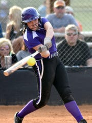 Clarksville High freshman Taylor Adkins swings at a