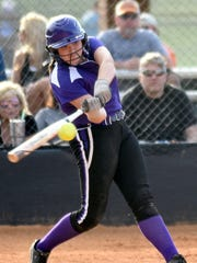 Clarksville High freshman Taylor Adkins swings at a first-inning pitch during a game in 2016.