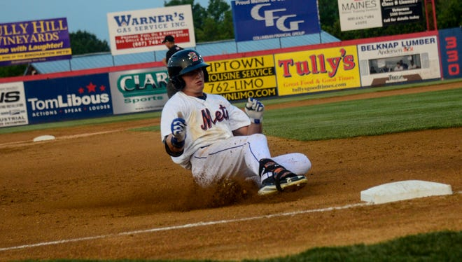 Brandon Nimmo slides into third after hitting a triple during during a game at NYSEG Stadium.
