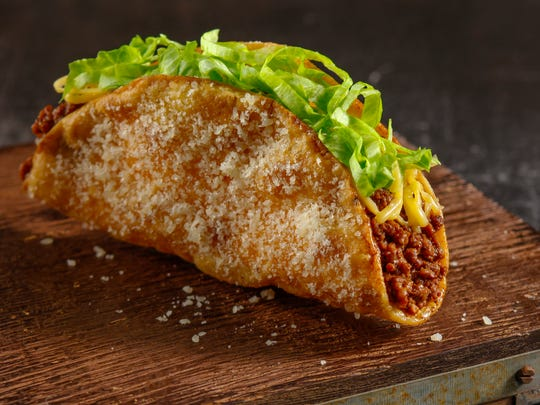  The signature item at Jimboy's Tacos, shown here, is a ground beef taco with cheese and lettuce in a Parmesan-dusted shell. For the off-menu Gypsy Taco, order double meat, double cheese, hold the lettuce.   
