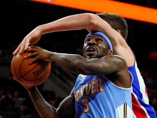 FILE- In this Feb. 6, 2015, file photo, Denver Nuggets guard Ty Lawson (3) is fouled by Detroit Pistons forward Jonas Jerebko (33) during the second half of an NBA basketball game in Auburn Hills, Mich. A person with direct knowledge of the deal said Monday, July 20, that the Denver Nuggets have agreed to send point guard Lawson to the Houston Rockets. (AP Photo/Paul Sancya, File)