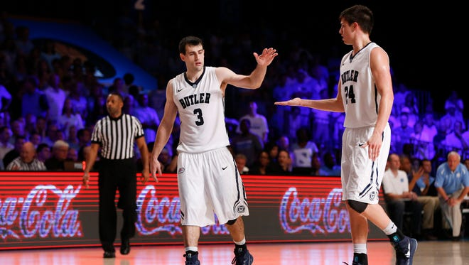 Nov 26, 2014; Paradise Island, BAHAMAS; Butler Bulldogs guard Alex Barlow (3) celebrates with guard Kellen Dunham (24) during the game against the North Carolina Tar Heels at Atlantis Resort Imperial Arena. Mandatory Credit: Kevin Jairaj-USA TODAY Sports