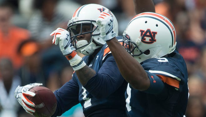 Auburn wide receiver D'haquille Williams (1) celebrates with Auburn wide receiver Ricardo Louis (5) after catching a touchdown pass during the Auburn A-Day spring game on Saturday, April 18, 2015, at Jordan-Hare Stadium in Auburn, Ala.