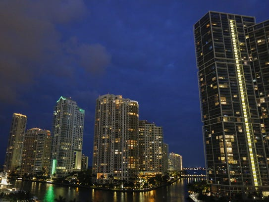 The Brickell Key skyline is seen at dusk in downtown
