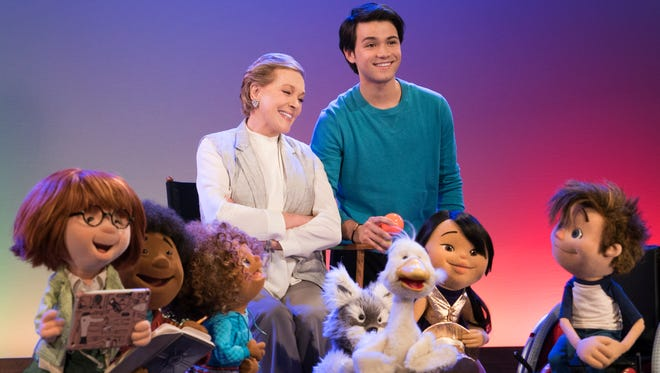Julie Andrews, seated left, and Guillian Gioiello will star in a Netflix preschool series, 'Julie's Greenroom,' that features new puppets from The Jim Henson Company.