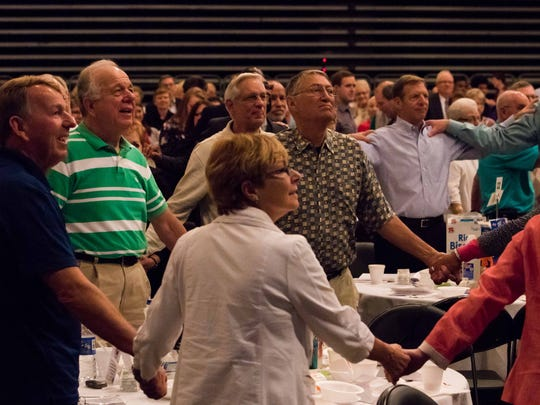 """Guest speaker Bob Goff urged everyone at the Community Prayer Breakfast to """"lift people everywhere up"""" and encouraged them to stand up and embrace one another."""
