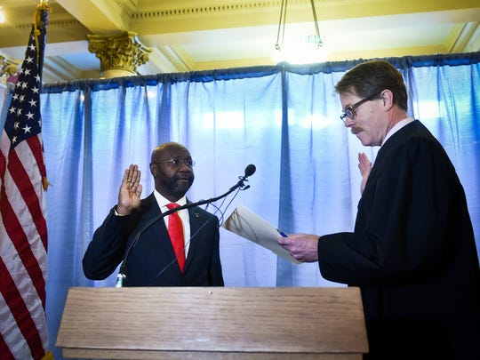 Helana's Mayor Wilmot Collins, left, is sworn into office by Judge Mike Menahan Jan. 2, 2018, in the Capitol Rotunda in Helena.
