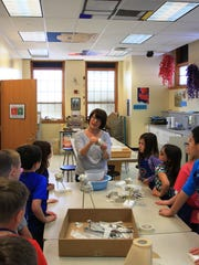 The Southwest Licking Arts Festival is a celebration of the arts in grades K-12. Here, Pataskala Elementary art teacher Julie Gold works with a class on a recent weekday.  The arts festival Wednesday, April 19 through Saturday, April 22 at Watkins Memorial High School.