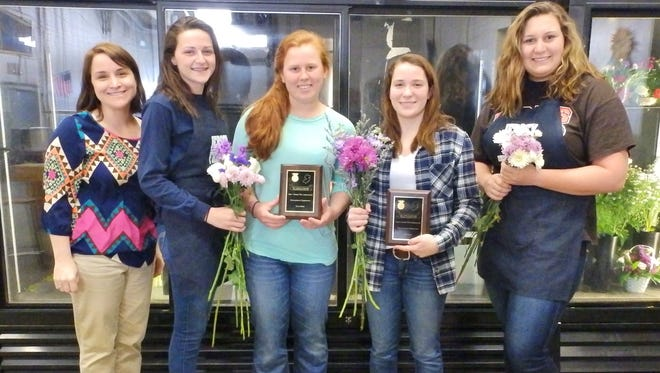 Cumberland Regional High School floriculture teacher and Future Farmers of America co-adviser Nichol Carroll, and students Taylor Ale, Madi Mayhew, Gillian Nardelli and Aimee Homan display Horticultural Exposition award plaques. The school's FFA chapter also will receive an award banner to celebrate its first-place state Floral Design Career Development Event win.