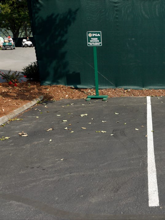 Tiger Woods' parking spot remains empty for the PGA Championship golf tournament at Valhalla Golf Club on Wednesday, Aug. 6, 2014, in Louisville, Ky. The tournament is set to begin on Thursday. (AP Photo/Mike Groll)