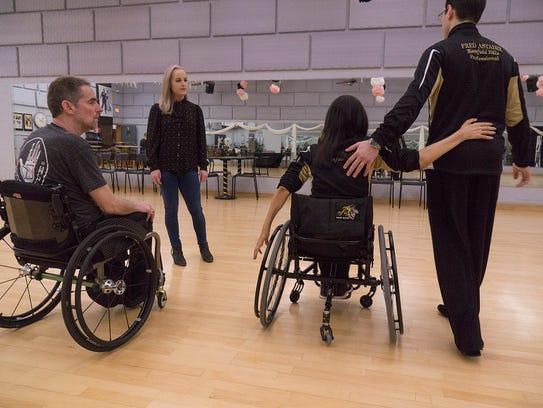 Instructors Tamerlan Gadirov and Cheryl Angelelli show