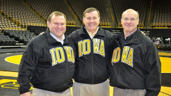 Ed Banach, left, Steve Banach, center, and Lou Banach, right, at Carver Hawkeye Arena in 2014.