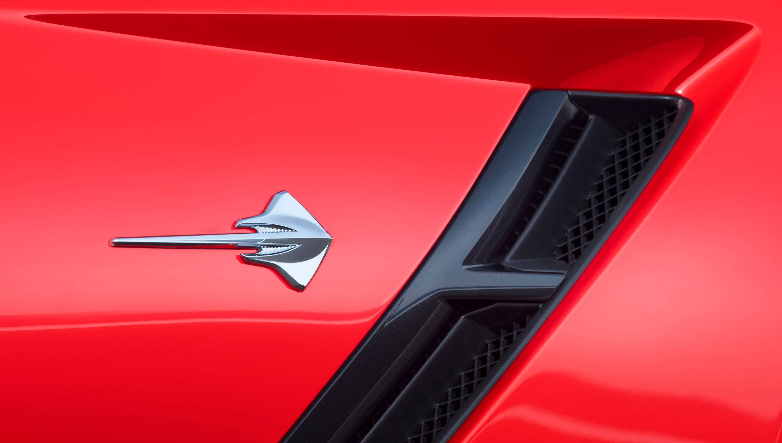 The 2014 Corvette's Stingray symbol behind the functional front fender vents.
