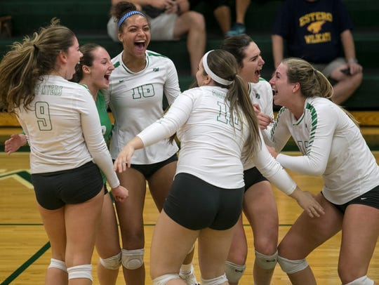 Fort Myers cheers after a point against Estero in the
