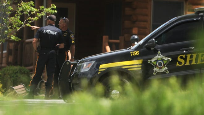 Two Sussex County Sheriff's officers serve security detail outside the home of Sussex County Sheriff Mike Strada on Monday.