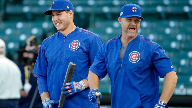 David Ross yuks it up with Anthony Rizzo during Friday's workout a day before Game 1 of the NLCS. Rizzo and Kris Bryant launched an Instagram account on Ross' behalf.