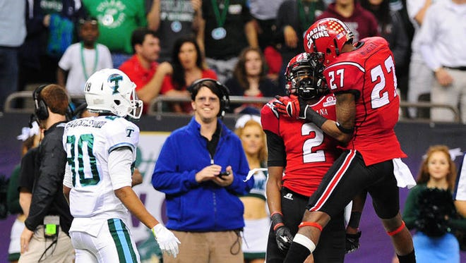 UL safety T.J. Worthy (27) celebrates with cornerback Simeon Thomas (2) after Thomas broke up a pass intended for Tulane receiver Justyn Shackleford (80) during UL's 2013 New Orleans Bowl win.