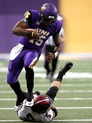 Northern Iowa quarterback Aaron Bailey, left, runs