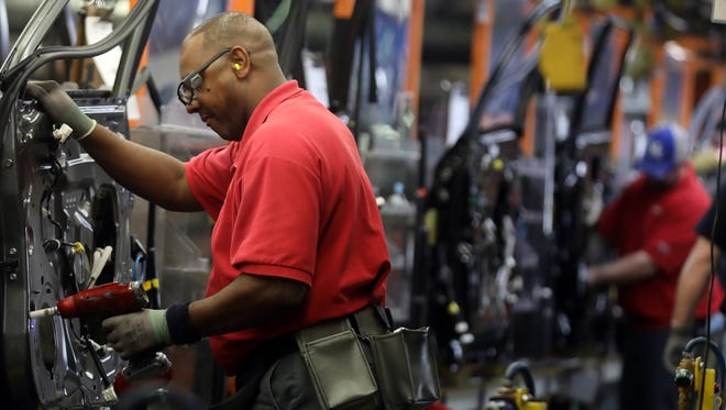 Employees at Nissan's Smyrna plant work on the assembly line Feb. 26, 2018.